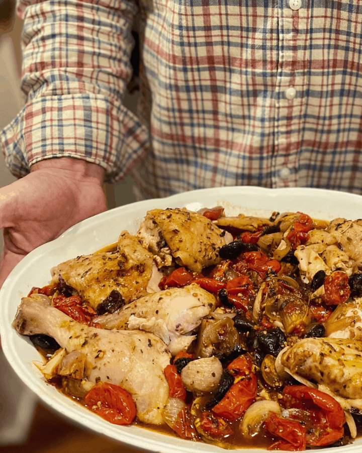 chicken provencal on white oval platter