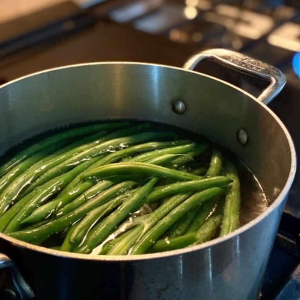 green beans in pot of boiling water