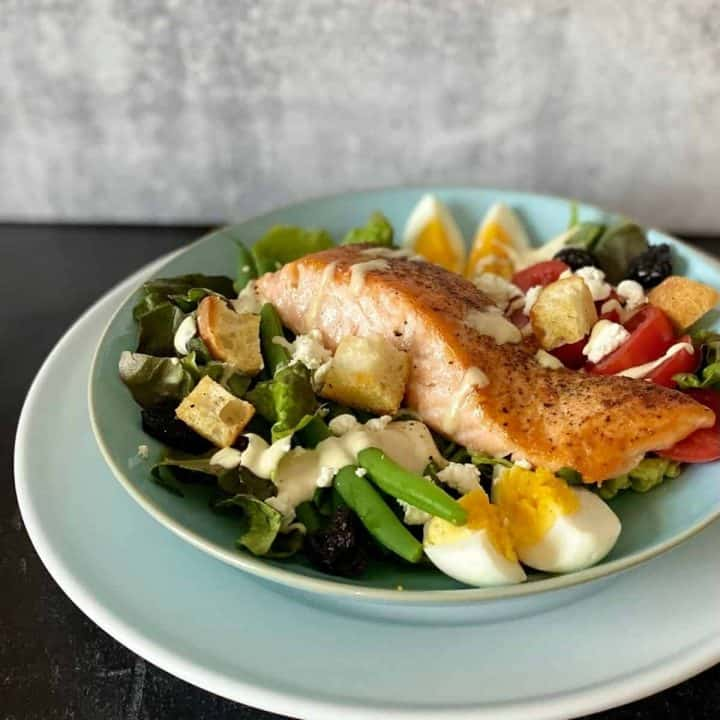 salmon salad on blue plate