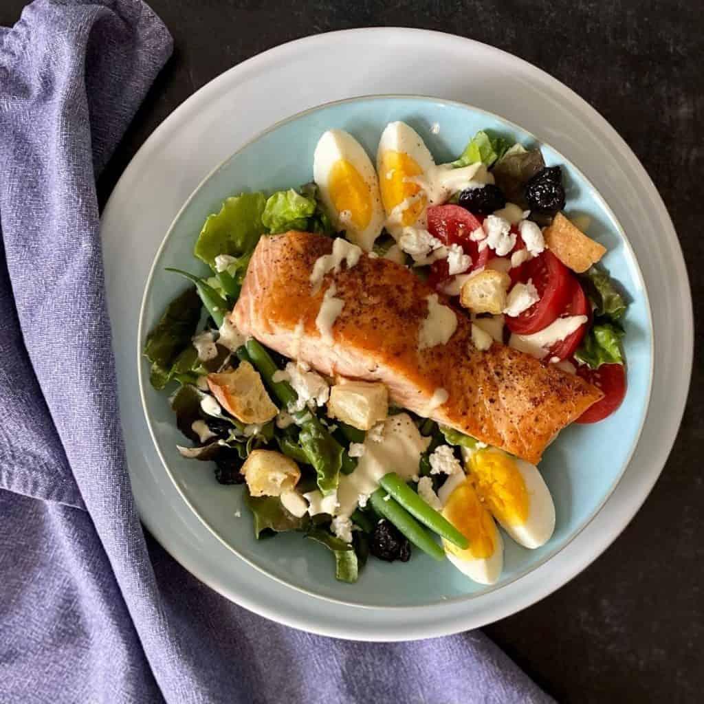 salmon salad on blue plate