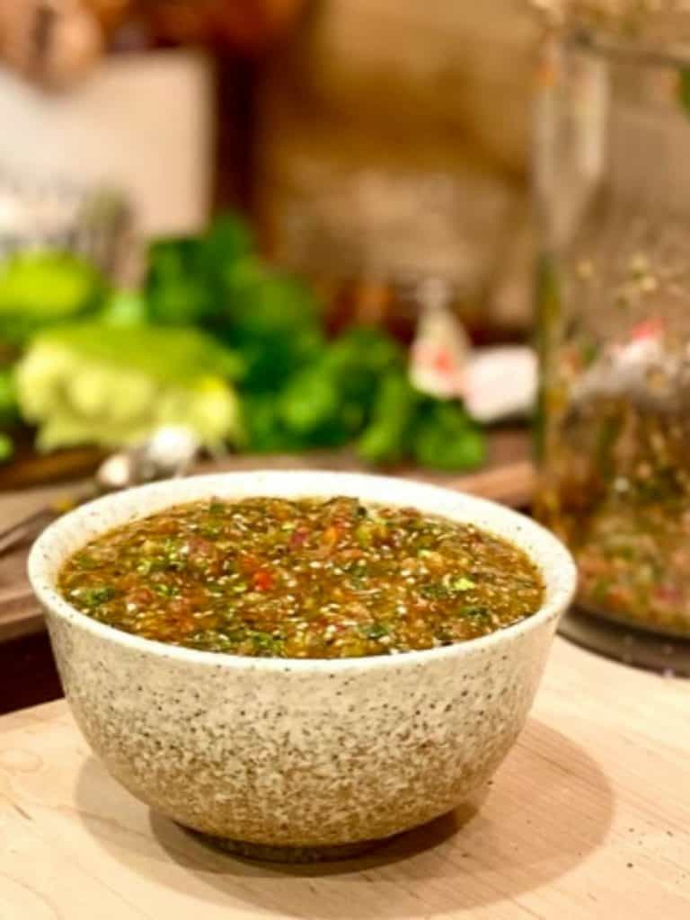 speckled bowl filled with tomatillo salsa