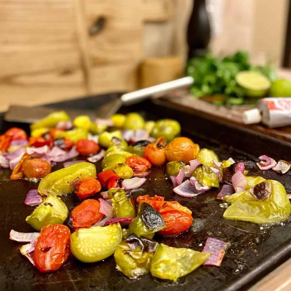 charred salsa ingredients on baking sheet