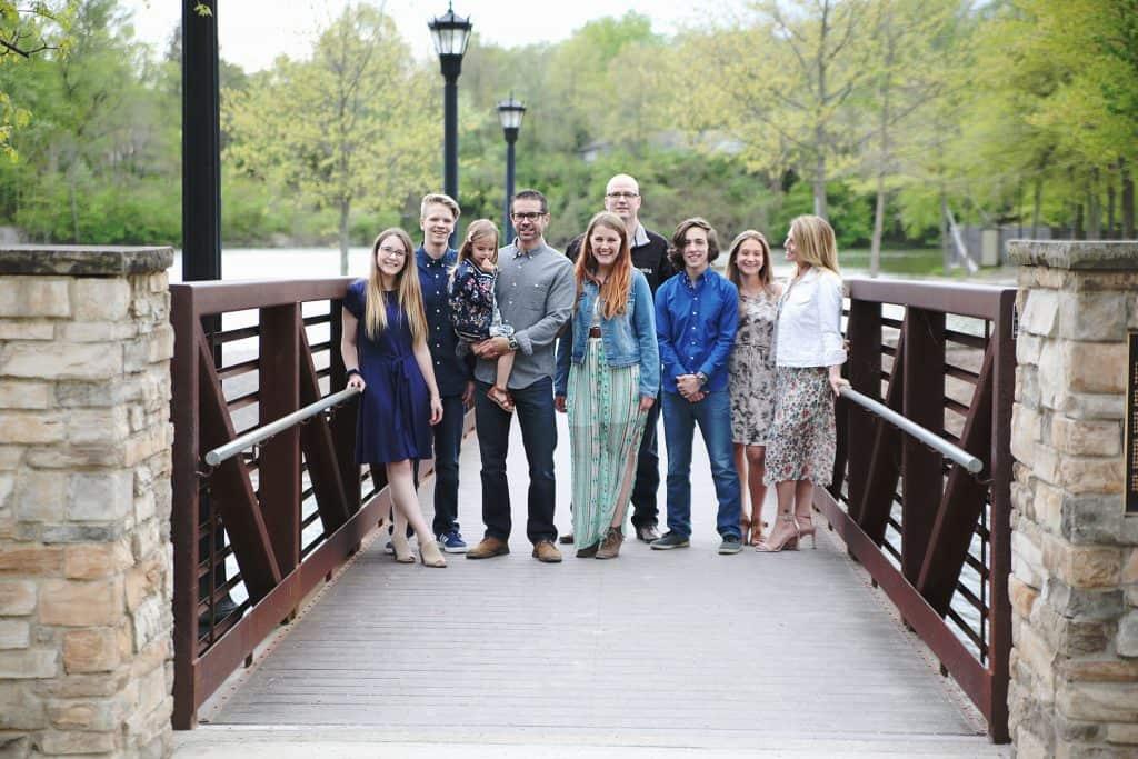 my family standing on bridge in park
