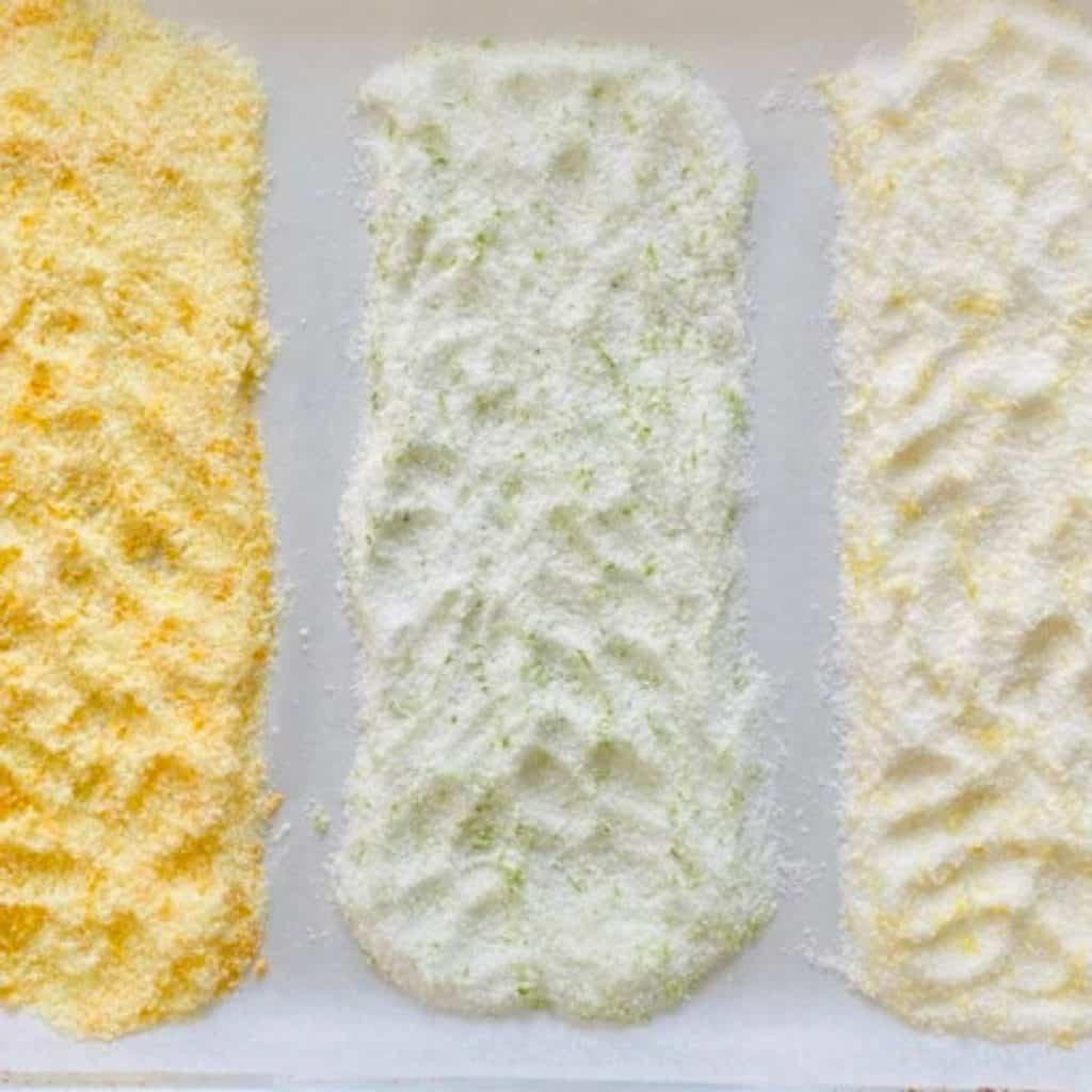 orange salt, lime salt and lemon salt strips on parchment paper