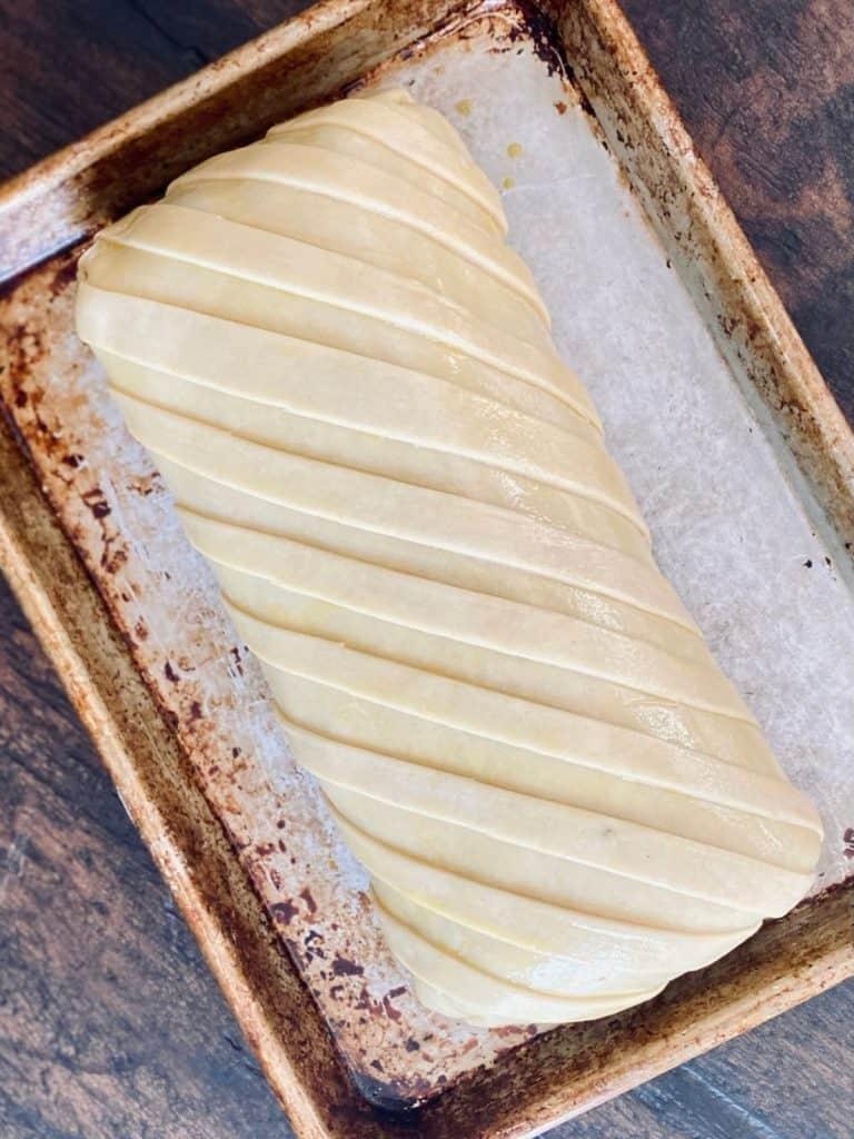 uncooked beef wellington on sheet pan