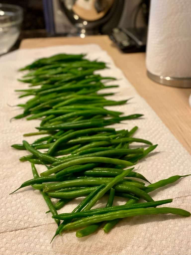green beans laid out on paper towel