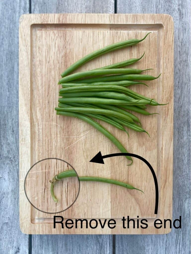 trimmed beans and one untrimmed bean with stem end magnified
