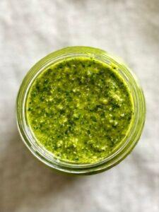 top view of pesto in glass jar