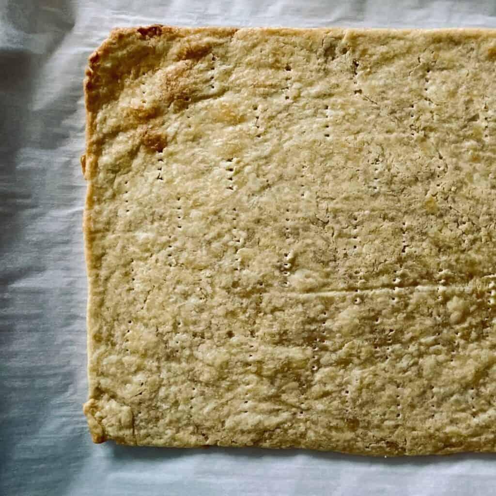 par baked tart dough pricked with fork