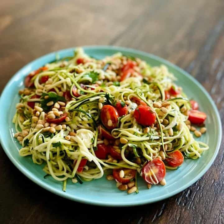 zucchini tomato salad in blue bowl