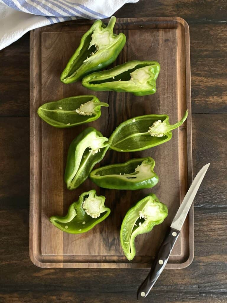 8 poblano halves on wooden board with knife
