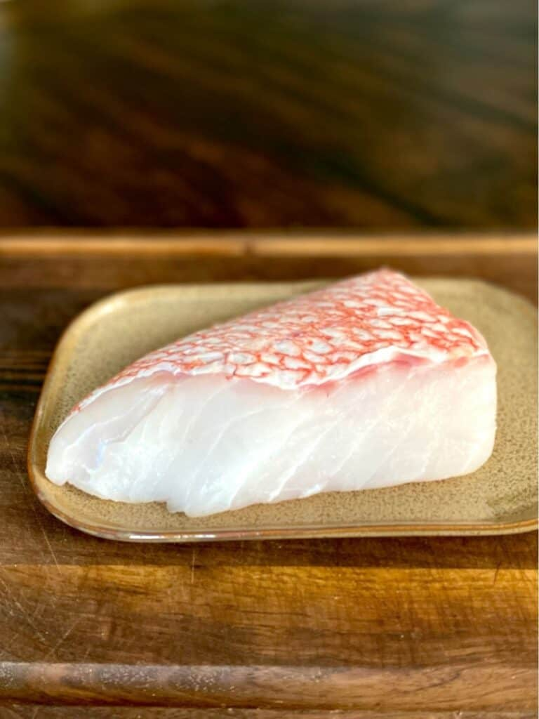 piece of rockfish on plate skin side up