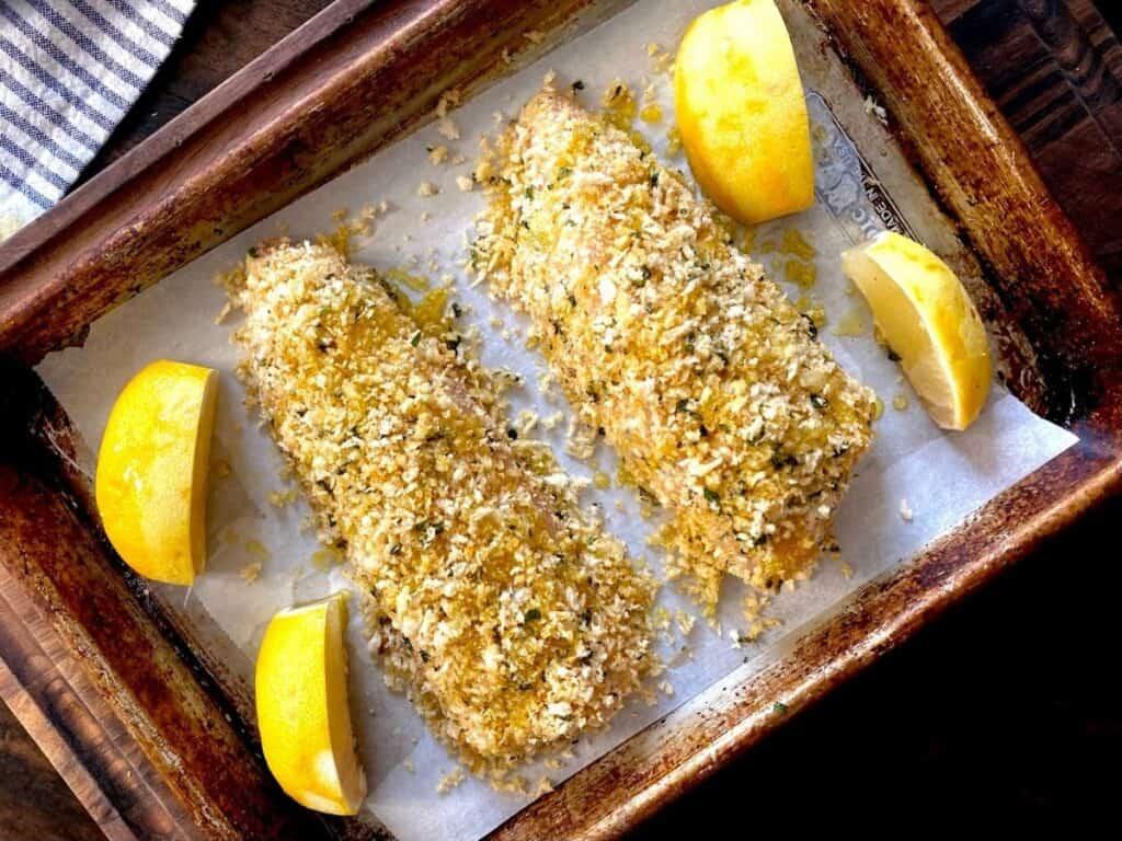 top view lemon basil rockfish on baking sheet with lemon wedges