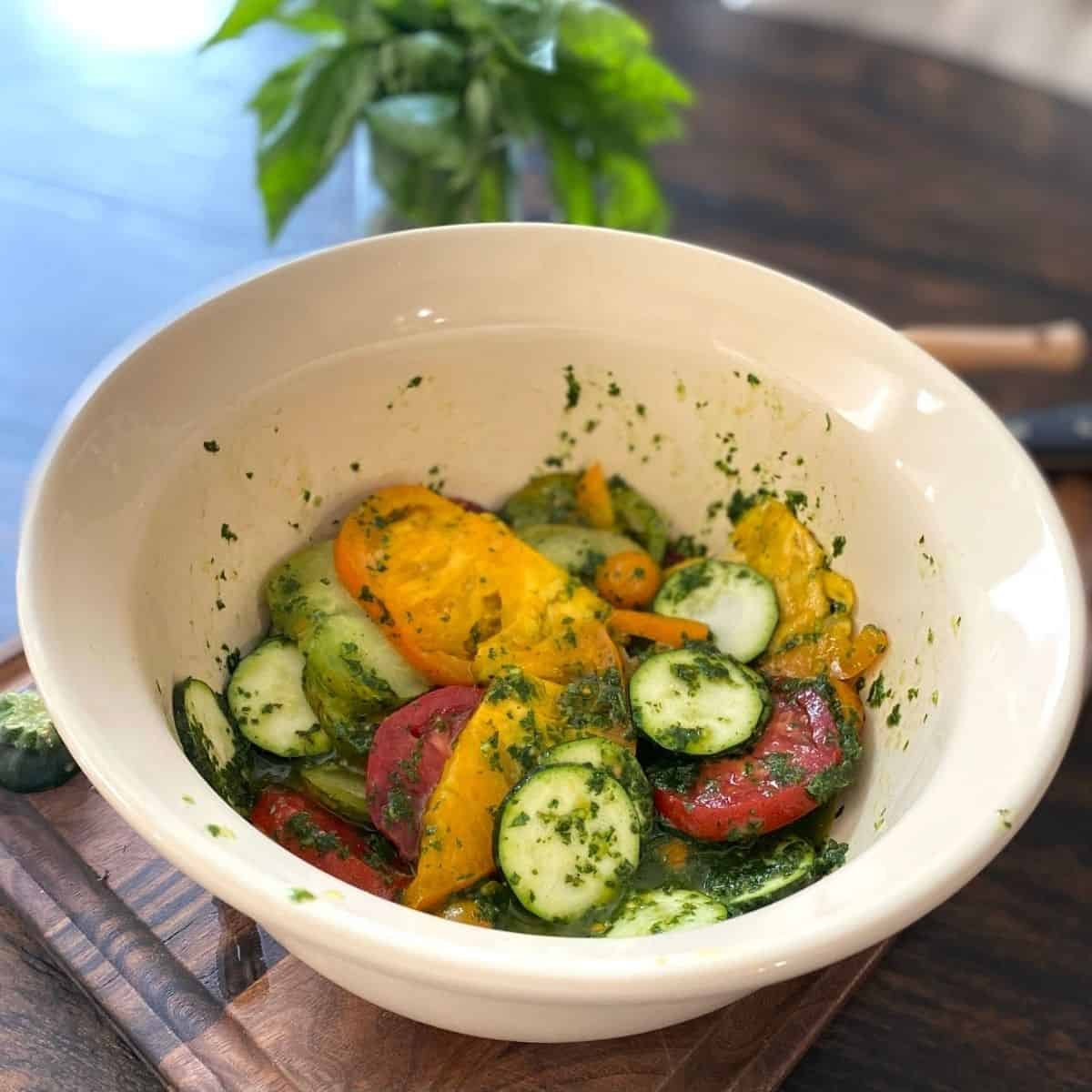 bowl of veggies tossed with herb mixture